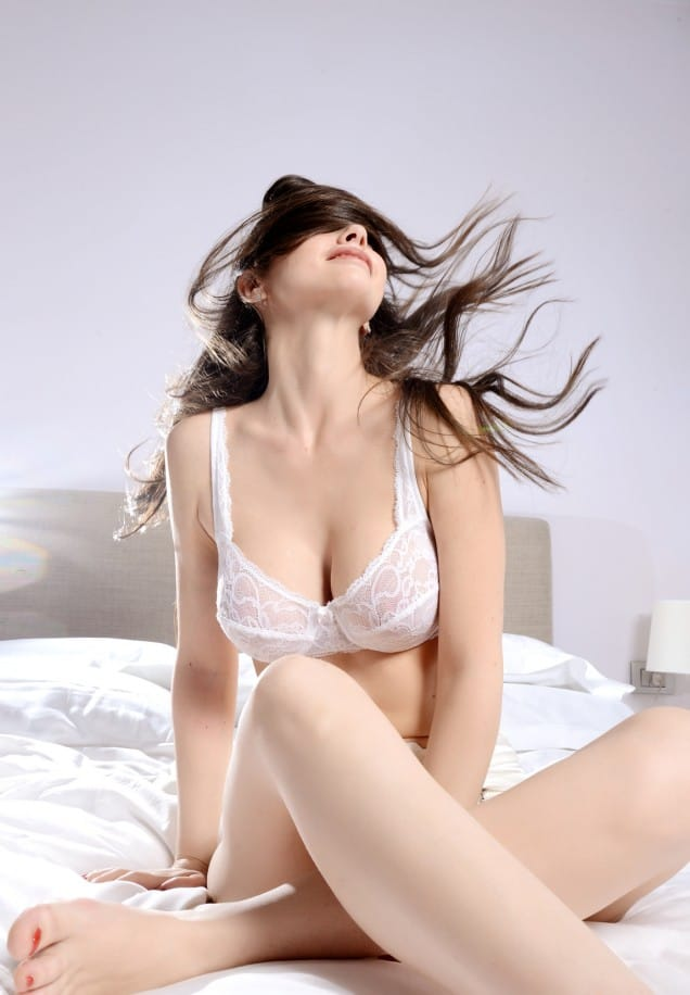 beautiful woman shake hair in bed at home